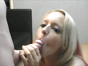 A blonde with a pierced tongue has fun with a cock