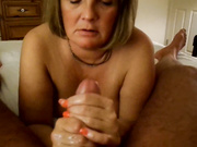 Older blonde uses her hands to make a cock cum a lot
