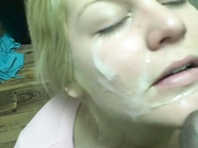A blonde slut is on her knees getting a BBC and cum
