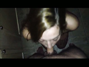 A brunette kneels in the bath while sucking
