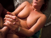 A tanned nanny with saggy tits jerks off a cock