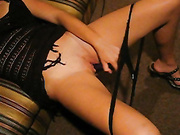 A brunette with a slim waist uses toys before getting cum